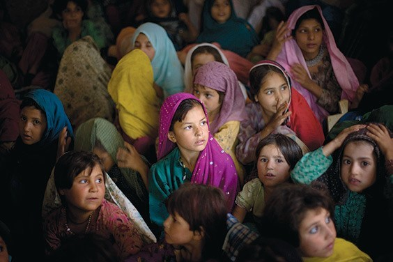 Pakistani girls from the Bajur tribal region in a school supported by UNICEF at the Katcha Garhi camp in Peshawar, Pakistan. Nearly 200,000 people have fled the fighting in Bajur regency to camps in Afghanistan and Pakistan.