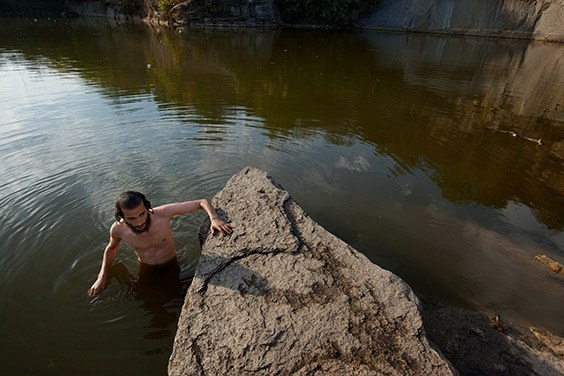 Ukraine, 2009  A Hasidic Jew in Ukraine immerses himself before Rosh Hashanah in a quarry pool that serves as a mikvah, a body of water used for spiritual cleansing.