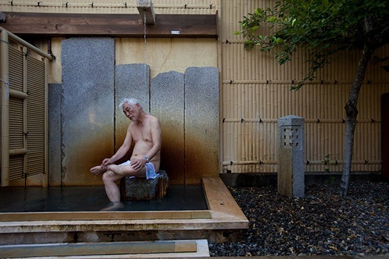 "Japan, 2009  Tending body and soul, Taizo Noda bathes in the mineral-rich waters of an onsen, or hot spring, near Osaka, Japan. Hours spent soaking, says the 72-year-old, are ""the secret of long life."""