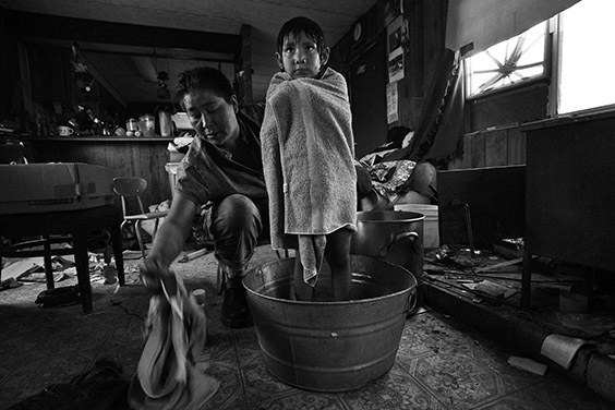 Thomasina Nez, 35, gives Bobbi, 4, a bath in a tin basin in their dilapidated trailer on a Navajo reservation in Cameron, Arizona. Without running water, Nez must bathe her children in water hauled from 30 miles away and heated on the family's wood stove. The Bennett Freeze ban, lifted officially in March 2009, prohibited some 8,000 Navajos living on 1.5-million acres of disputed land in Arizona from erecting or repairing their homes, including putting in water lines, unless approved by the neighboring Hopi. Consequently, the U.S. Bureau of Indian Affairs says 77 percent of the homes in the area aren't suitable to live in.