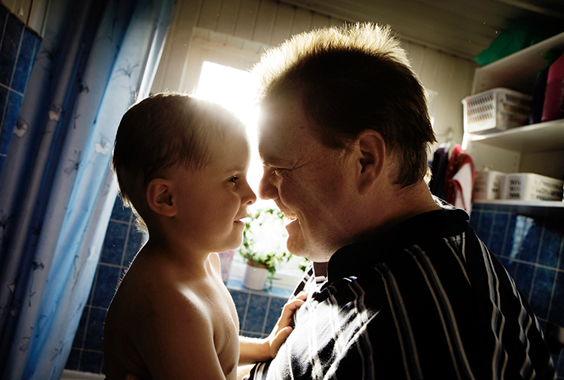 Vibe and her father Michael enjoy a playful moment in the bathroom at their home in Hundested, Denmark.