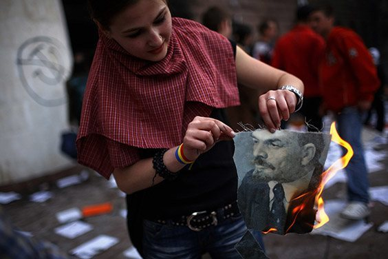 A young Moldovan girl burns a portrait of Vladimir Lenin that rioters had taken from the parliament building in Chisinau, Moldova, on April 7, 2009. Thousands of demonstrators had ransacked the building to protest what they said was a fraudulent victory by the governing Communist Party in the general election on April 5.