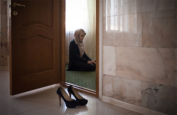 Amina Mutieva , 21, a student at the Islamic University in Grozny prays in a prayer room for women.