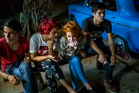 Helen and friends wait for their $1.00 cheese pizzas in Playa neighborhood, Havana, from the series Paradiso, 2015